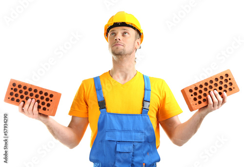 Portrait of young builder isolated on white