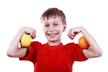 Beautiful strong blond boy in red t-shirt with apple and orange