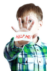 "Beautiful blond boy shows a message ""Help me!"""