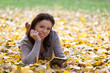 Cute girl with autumn background.