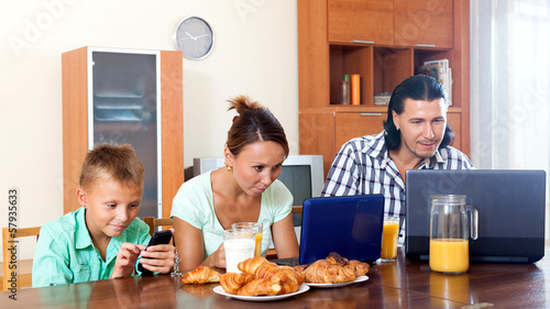 couple with teenager son  during breakfast