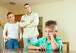 teenage son and parents having quarrel