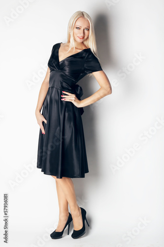 beautiful woman in elegant silk dress in  fashion pose. studio s