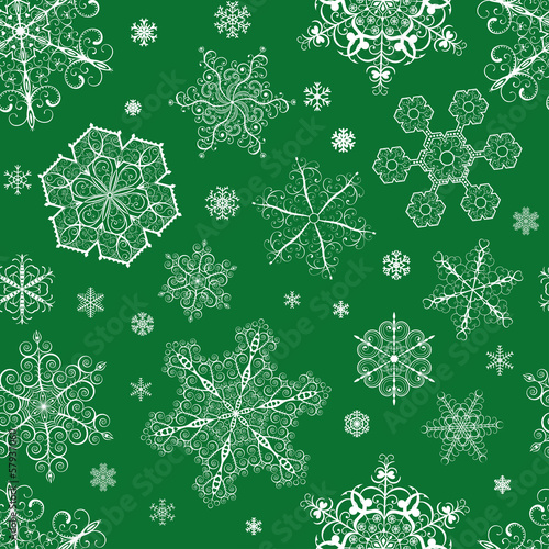 Christmas seamless pattern of snowflakes on green