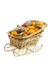 Christmas decorative sledge with fresh clementines and nuts.