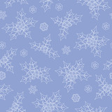 Seamless blue Christmas pattern with holly and snowflakes