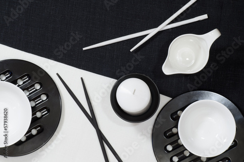 White porcelain on black and white linen tablecloths.