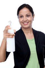 Young woman holding a spray cleaner