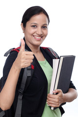 Successful female student with thumbs up