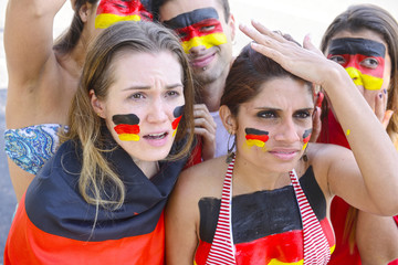 German group of soccer fan disappointed with team defeat.