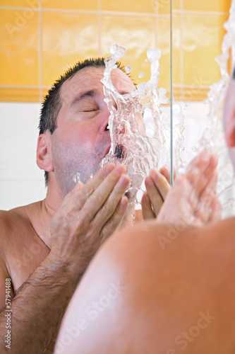 Man washing face