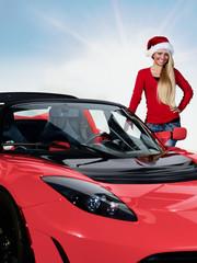 Miss Santa has a modern sleigh