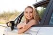 canvas print picture - junge lachende frau im autofenster sommer