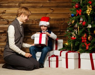 Mother and her lIttle boy under christmas tree