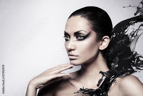 portrait of sexy brunette woman with black splash