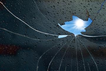 Blue sky sunny day behind a broken glass