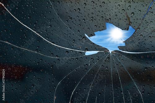 Leinwandbild Motiv Blue sky sunny day behind a broken glass