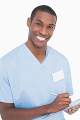 Portrait of a smiling male surgeon with clipboard