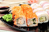 Japanese rolls with masago caviar, cheese and cucumber
