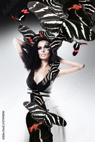 monochrome style woman with art make up and zebra butterflies