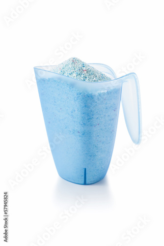 Washing Detergent Powder in a Measuring Cup