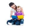 young mom reading a book to her baby