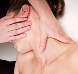 A woman getting relaxing massage on trapezius muscles of the nec