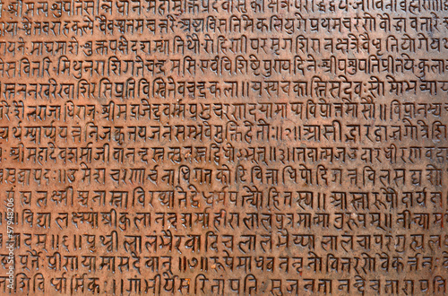 Fotobehang Nepal Background with ancient sanskrit text etched into a stone tablet