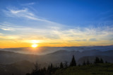 Fototapety sunrise over black forest mist
