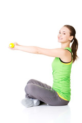 Attractive young woman sittinh and holding free weights.