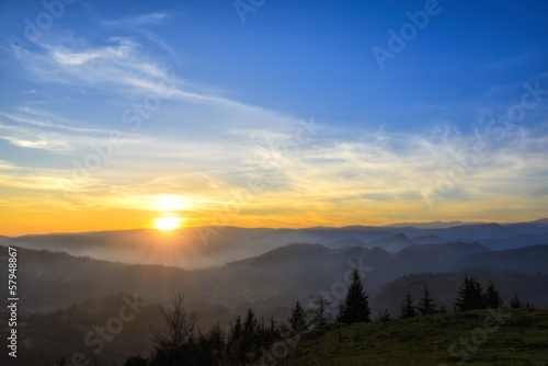 sunrise over black forest mist