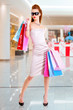 Beautiful fashion woman with shopping bags