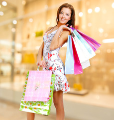 woman with shopping bags at shop