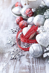 Christmas ornaments and gift ribbon on painted wood