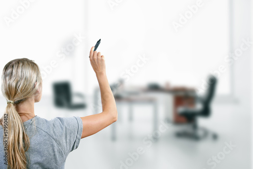woman with black marker in the hand at the office