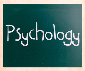 The word 'Psychology' handwritten with white chalk on a blackboa