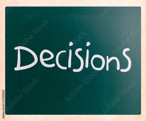 "The word ""Decisions"" handwritten with white chalk on a blackboar"