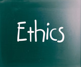 "The word ""Ethics"" handwritten with white chalk on a blackboard"