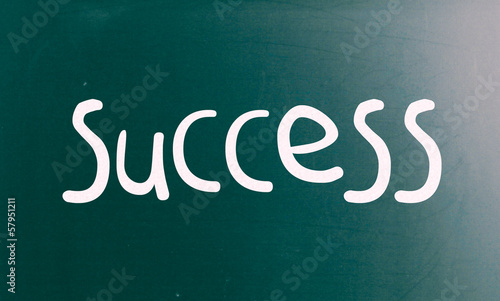 "The word ""Success"" handwritten with white chalk on a blackboard"