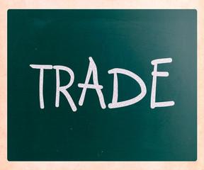 """Trade"" handwritten with white chalk on a blackboard"