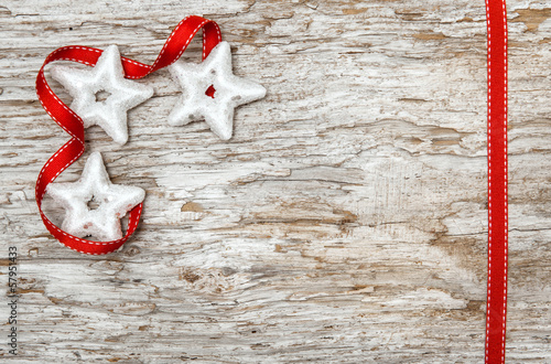 Christmas decoration with red ribbon and silver stars