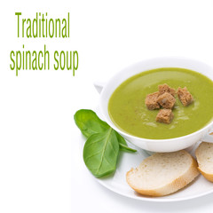 delicious spinach soup with croutons in a bowl, isolated