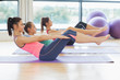 Class stretching on mats at yoga class