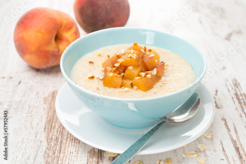 oatmeal with caramelized peaches in a bowl for breakfast