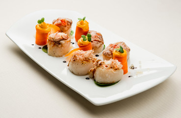 Delightful dish with fish fillet and carrot with pumpkin sauce