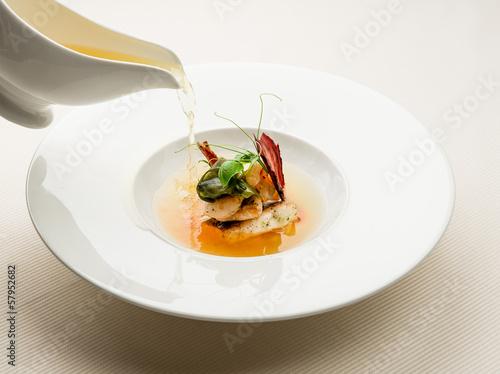 White bowl of fresh seafood soup