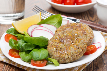 vegetarian burgers made from lentils and buckwheat on the plate