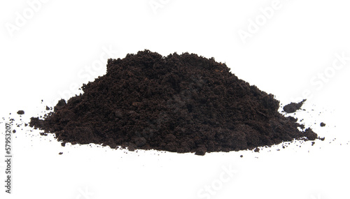 Pile of black garden top soil over white background