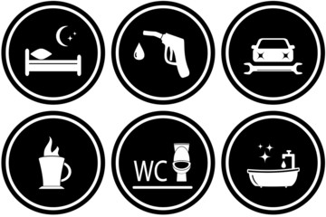 black set round road signs for hotel or gas station