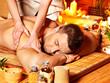 Woman getting bamboo massage.